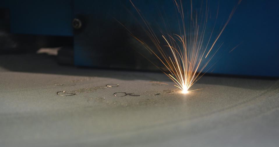 Laser sintering machine for metal. 3D printer printing metal.