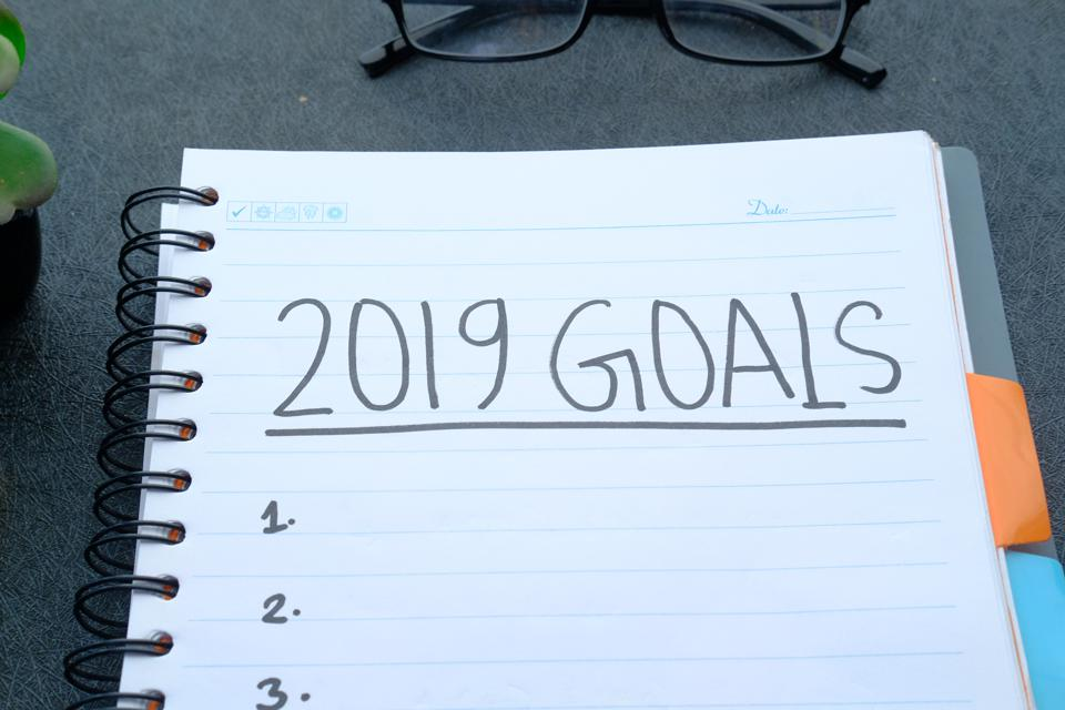 the year goals written on note pad