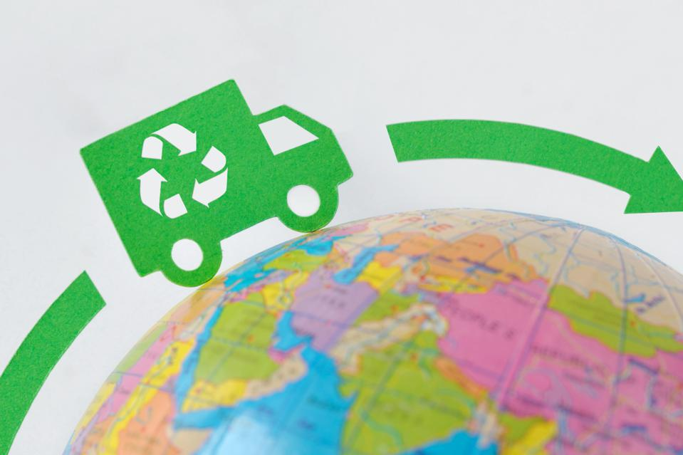 Green truck on earth globe - Ecological transport