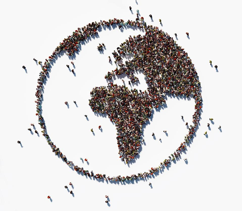 Human Crowd Forming World Symbol: Population And Social Media Concept