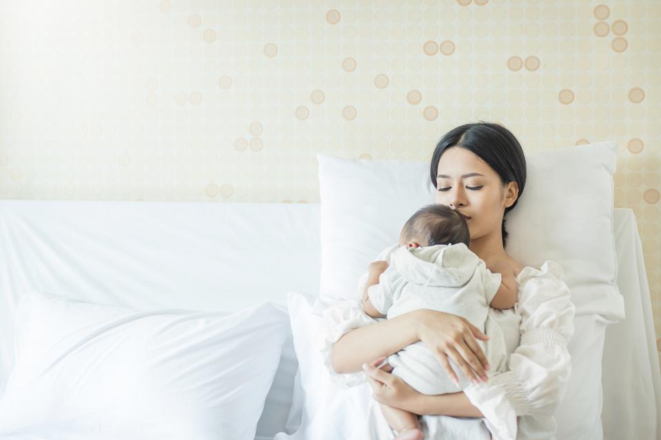 Close up portrait of beautiful young asian mother with newborn baby