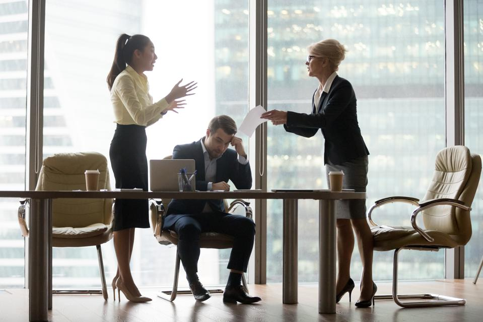 Dissatisfied, angry director business woman criticizing work