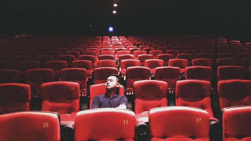 Man Sitting In Theatre