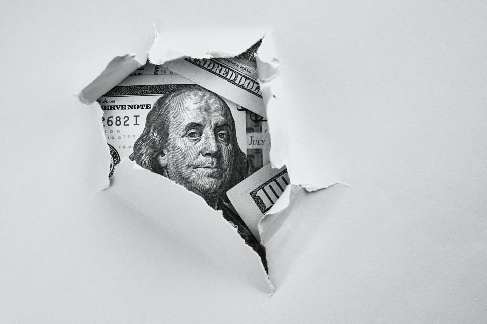 Money under holed paper