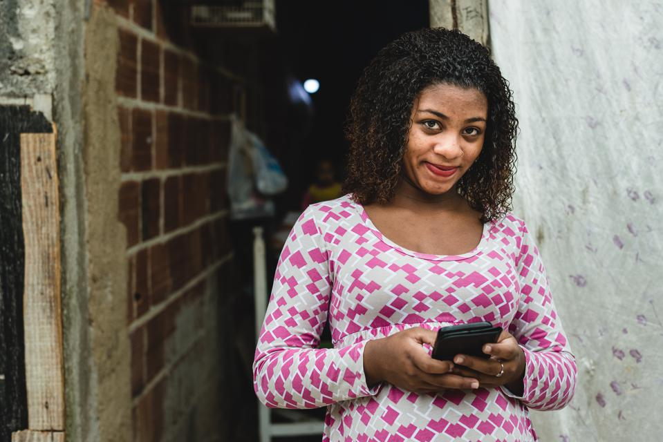 Teenager Brazilian using a smartphone
