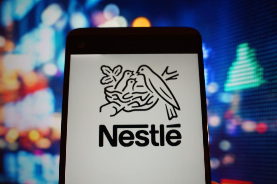 The logo of  Nestle is seen in a smartphone