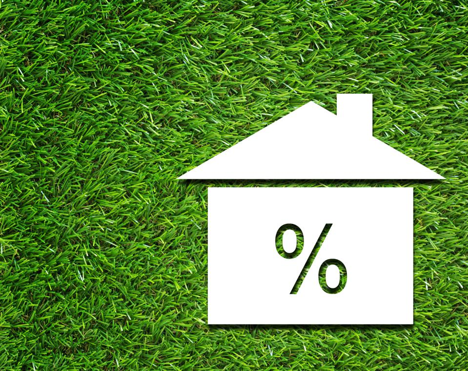 Interest Rate Symbol on Grass Background