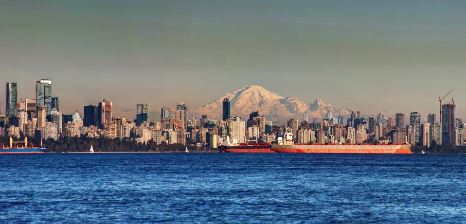 panorama of Downtown Vancouver with Mt Baker at sunset