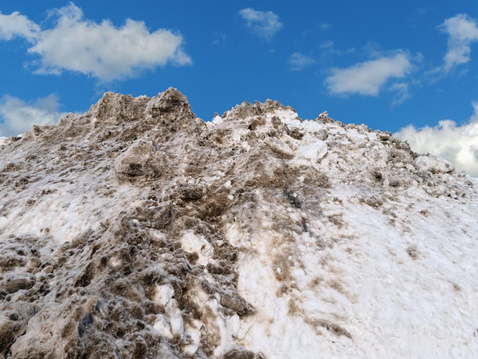 Soot on Snowpile from Pollution on Road