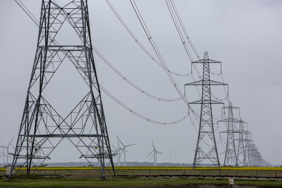 Wind Turbines And Electricity Pylons