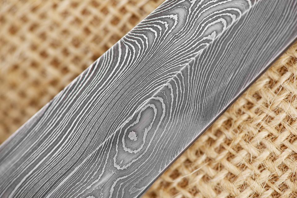 Traditional handmade Finnish knife made of Damascus steel.