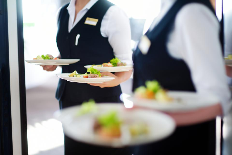 Waiter carrying plates