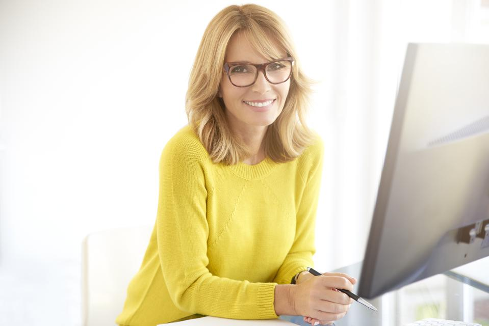 Confident smiling mature businesswoman in the office