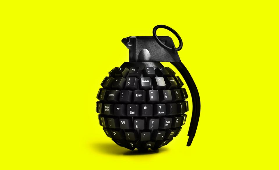 cyber attack grenade on yellow background