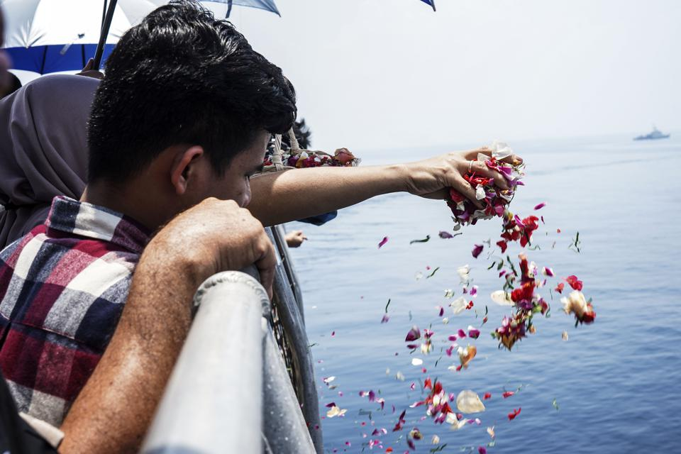 Relative of Victims Lion Air JT-610 Sprinkles Flowers