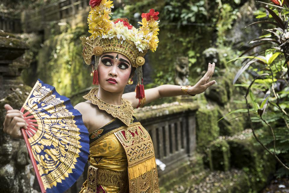 Young traditional Bali dancer in a bamboo forest