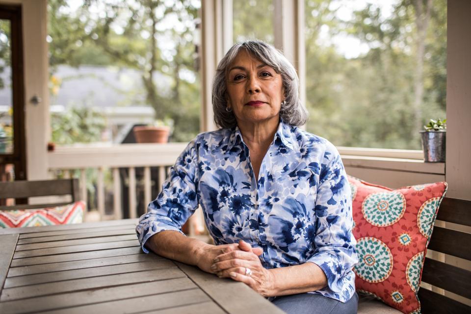 Portrait of senior woman sitting on porch