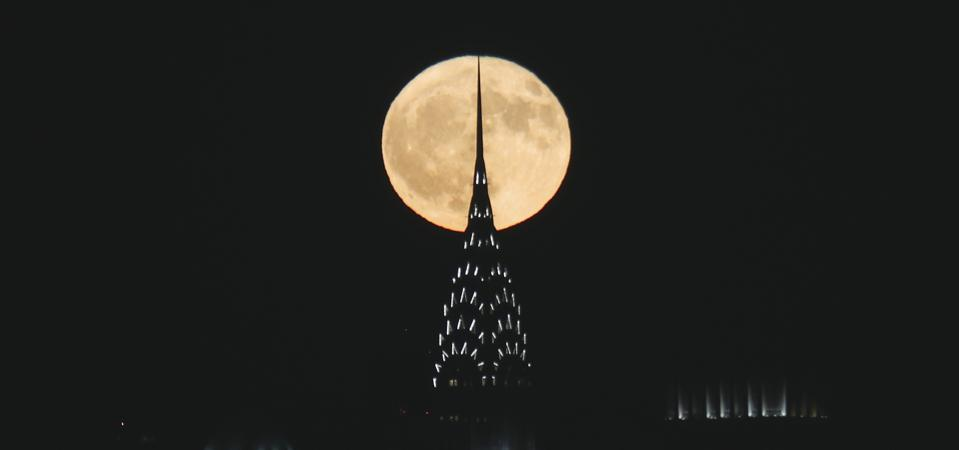 The full Hunter's Moon rises behind the Chrysler Building in New York City on October 24, 2018 as seen from Jersey City, New Jersey. (Photo by Gary Hershorn/Getty Images)