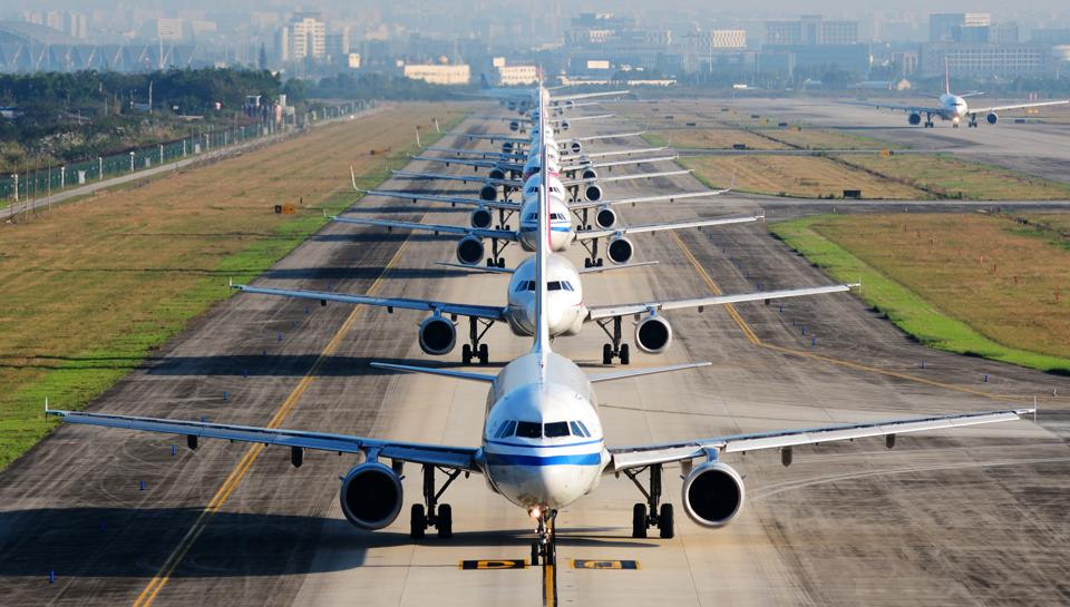 Planes waiting for takeoff. Do you know your airline rights?