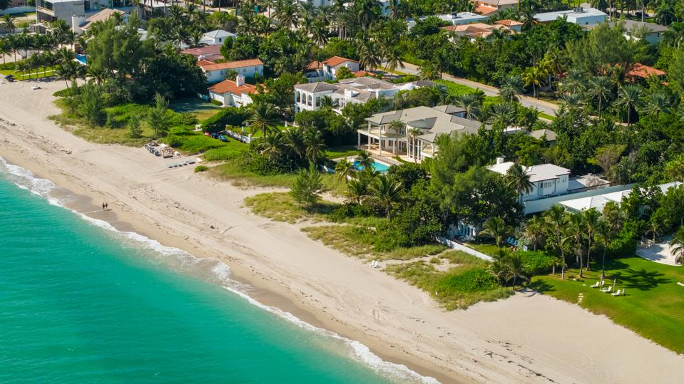 Aerial photo of luxury beachfront mansions in South Florida