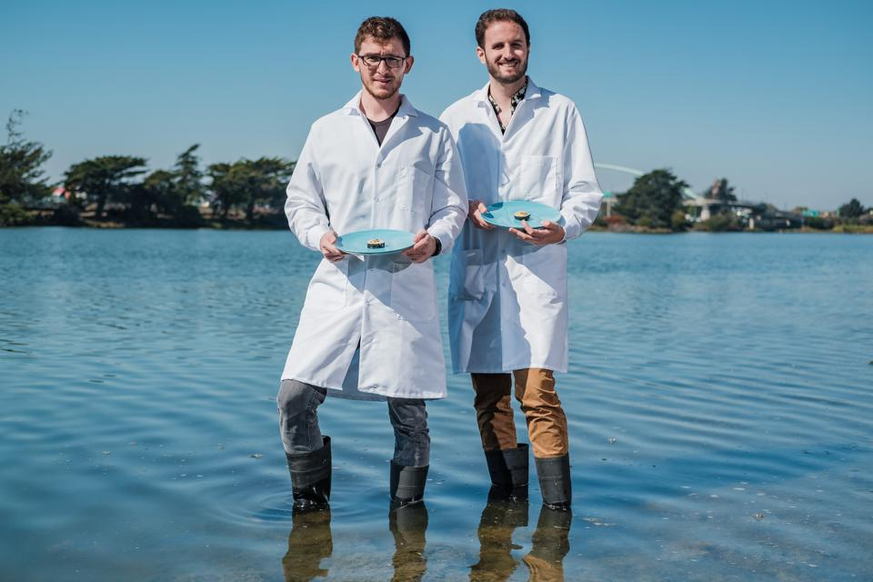 Finless Foods founders posing with lab-grown bluefin tuna.