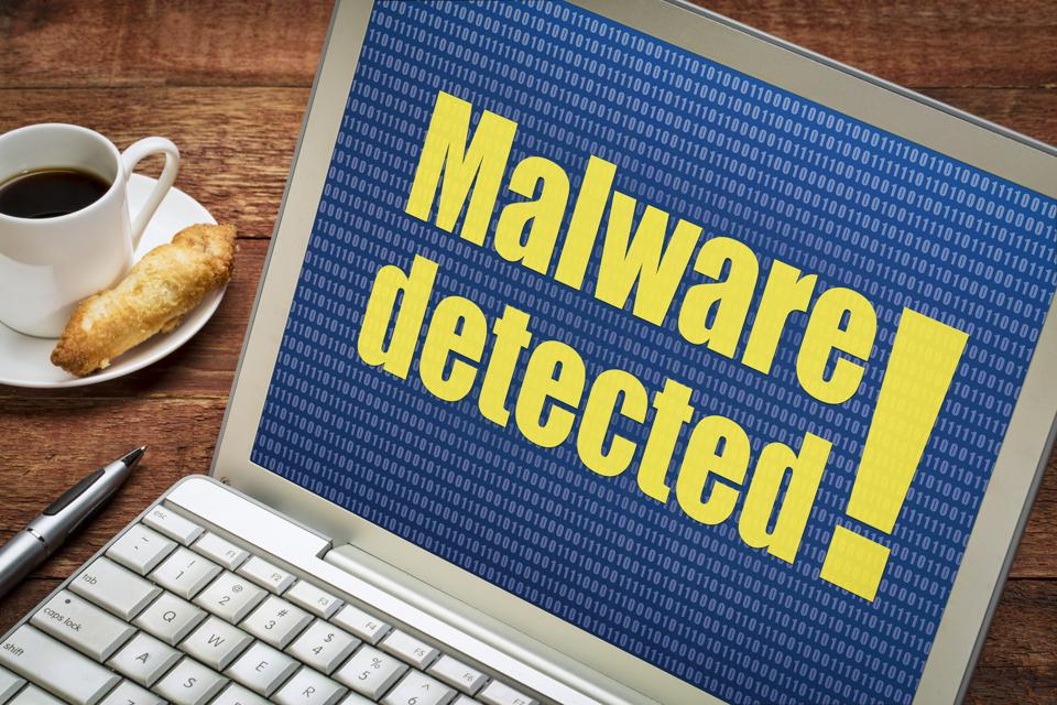 malware detected alert on laptop screen