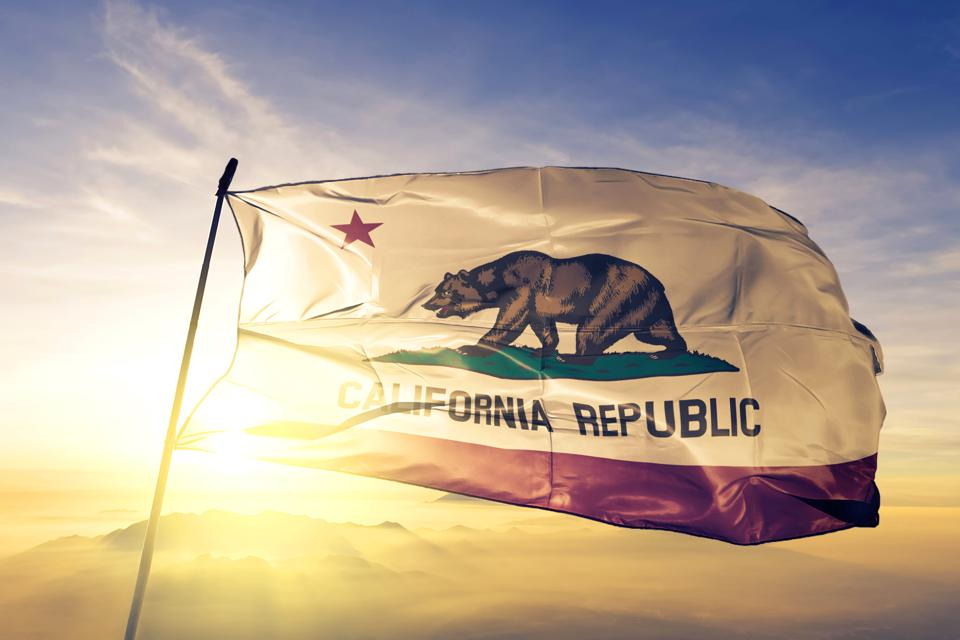 California state of United States flag textile cloth fabric waving on the top sunrise mist fog