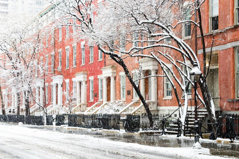 Snow covered winter street scene in New York City after nor'easter storm