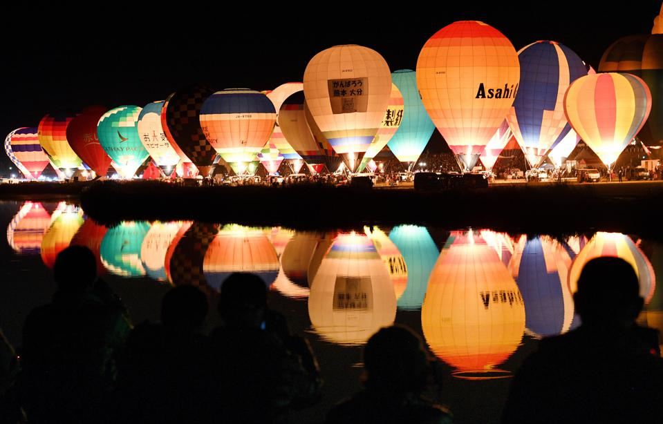 Lineup Of Hot Air Balloons Glow In The Night At Saga Festival