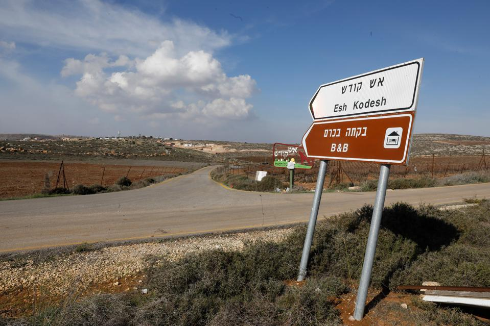 A road sign points towards an Airbnb apartment, located near the Jewish settlement of Shilo.
