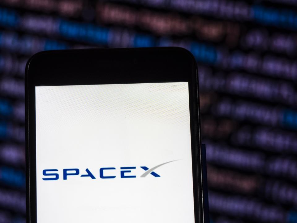 SpaceX Aerospace company logo seen displayed on smart phone