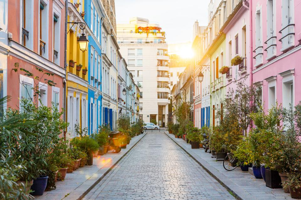 Rue Cremieux multicolored street during sunrise without people in Paris, France