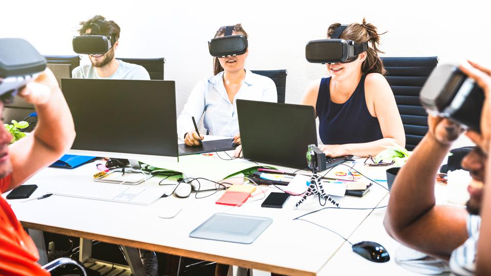 Group of young people employee workers having fun with vr virtual reality goggles in startup studio - Human resource business concept on millennials working time - Start up entrepreneurs at office