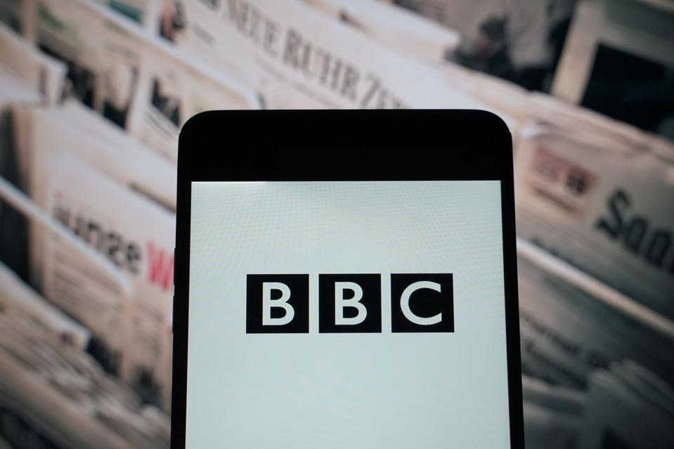 The logo of  BBC is seen on a smartphone