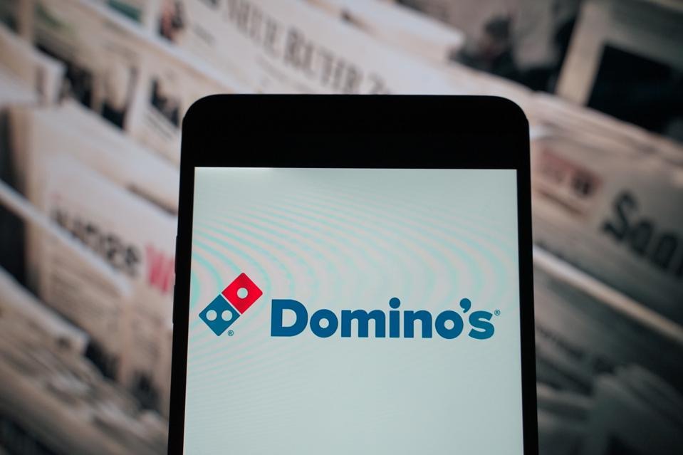 The logo of  Domino's is seen on a smartphone