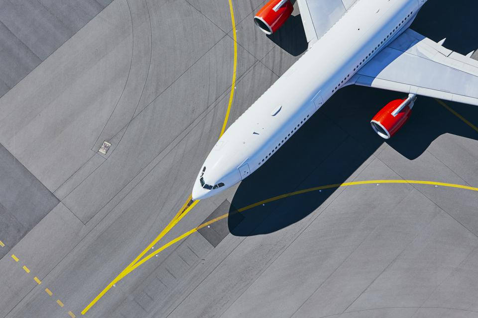 High Angle View Of Airplane At Airport Runway. Is now the time for an airline passengers' bill of rights?