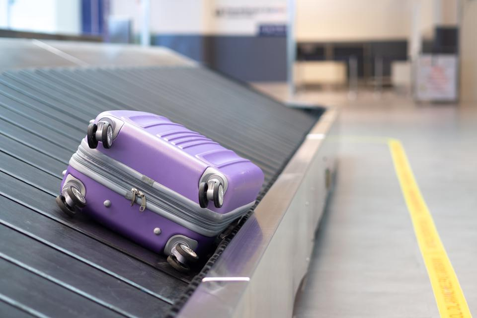 Suitcase or luggage with conveyor belt in the airport. Lost luggage