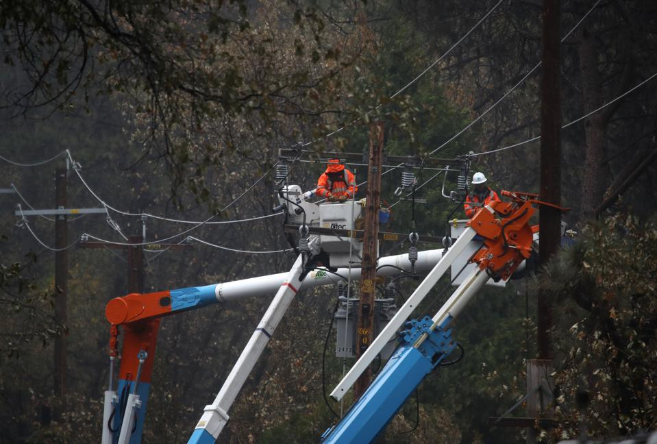 PG&E crews repair power lines that were destroyed by the 2018 Camp Fire.