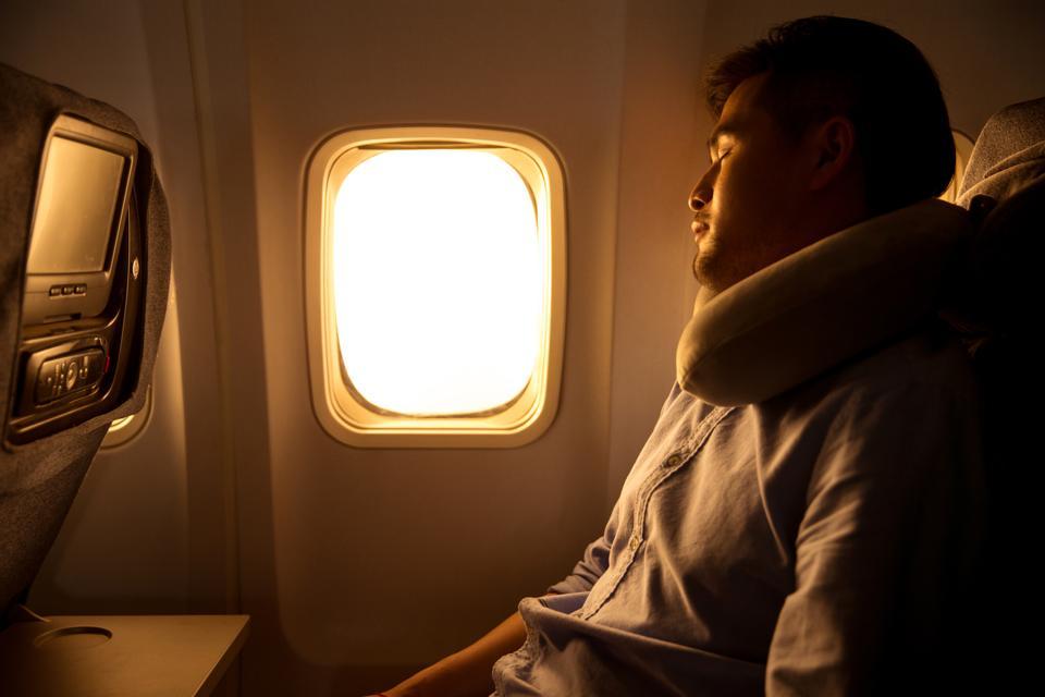 How to sleep on a flight like a pro.