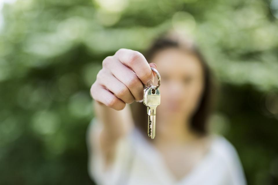 Close-up of woman holding key