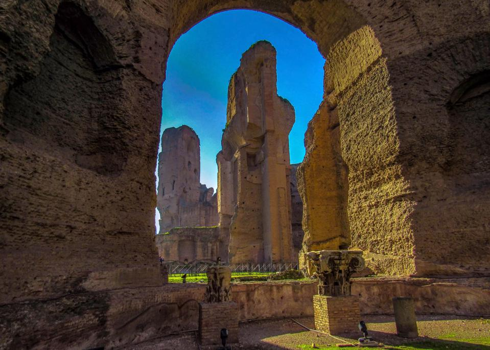 The Baths of Caracalla with blue clear sky in Rome, Italy