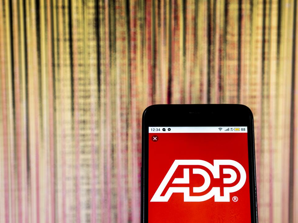 ADP, LLC Management services company  logo seen displayed on