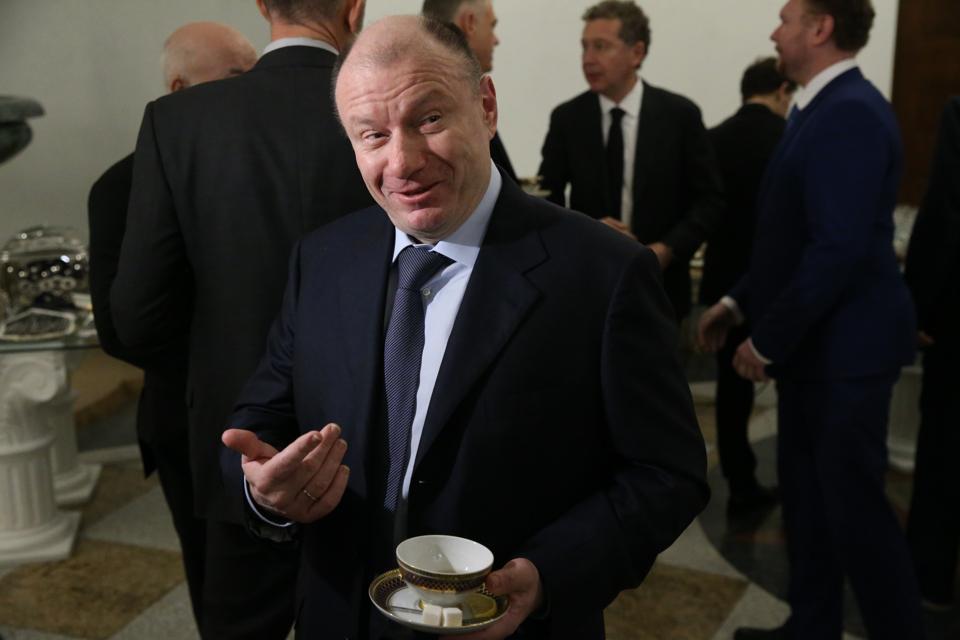 Russian President Vladimir Putin receives top businessmen at the Kremlin