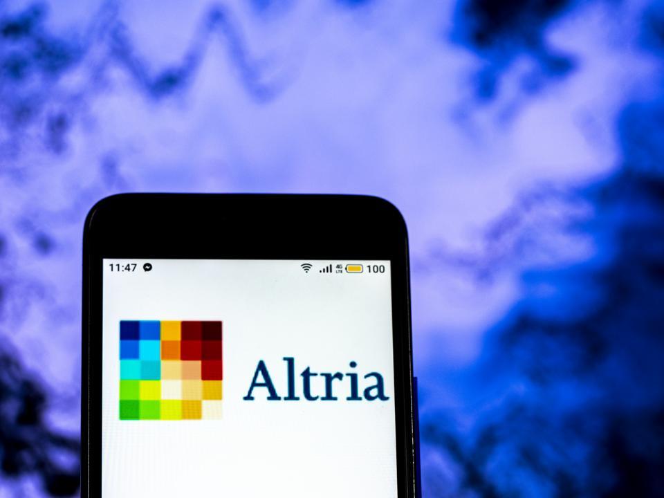 Altria Tobacco company logo seen displayed on a smart phone