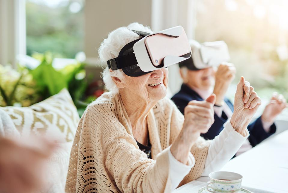 Stay connected to the joys of life. Shot of happy senior women using virtual reality headsets together at a retirement home