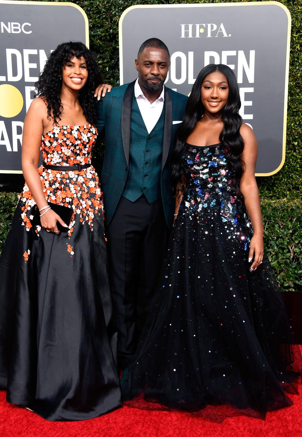 Idris Elba poses with his fiancée Sabrina Dhowre and daughter, Isan, who is this year's Golden Globes ambassador.