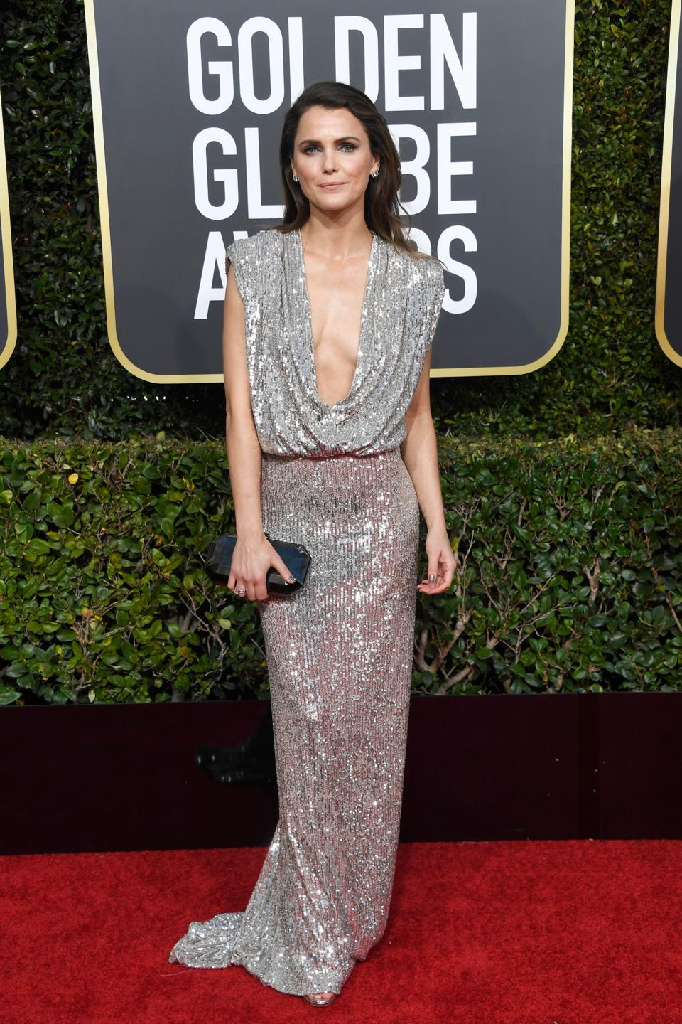 Keri Russell looks gorgeous in a plunging metallic ensemble by Monique Lhuillier.