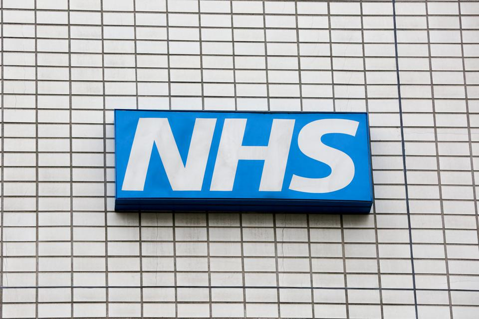 A National Health Service logo is seen outside a hospital in...