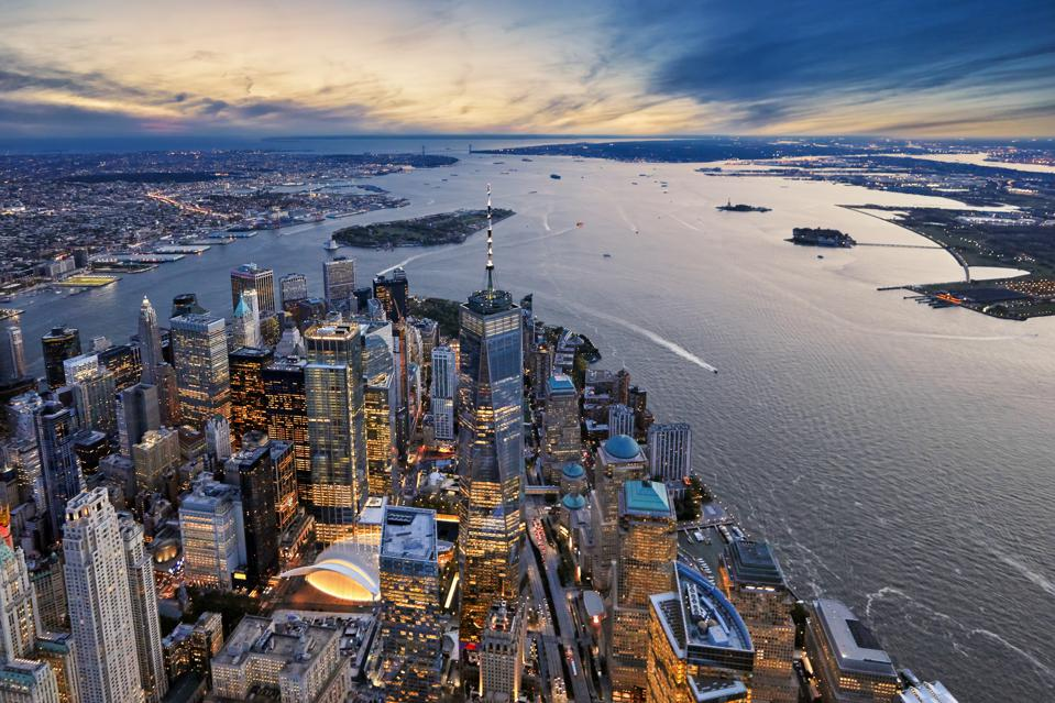 Aerial view of Manhattan island and harbor at dusk, New York City, New York State, United States