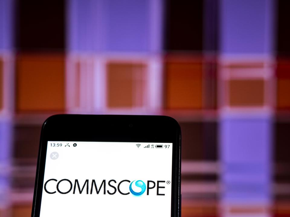 CommScope Company logo seen displayed on a smart phone